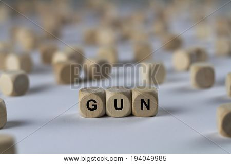 Gun - Cube With Letters, Sign With Wooden Cubes