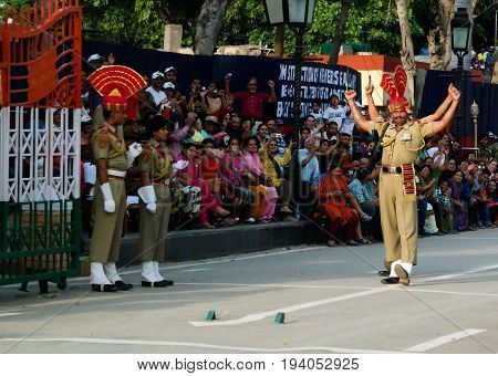 The marching Indian guards in national uniform at the ceremony of lowering the flags - 04-05-2015 border between Pakistan and India Wagah Lahore Pakistan