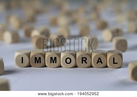Immoral - Cube With Letters, Sign With Wooden Cubes