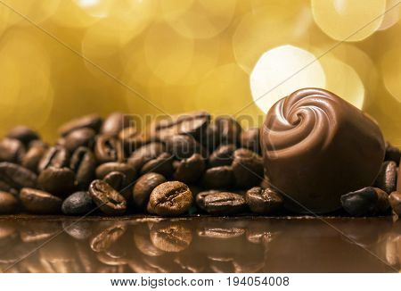 Endorphin caffeine concept - chocolate and coffee beans background
