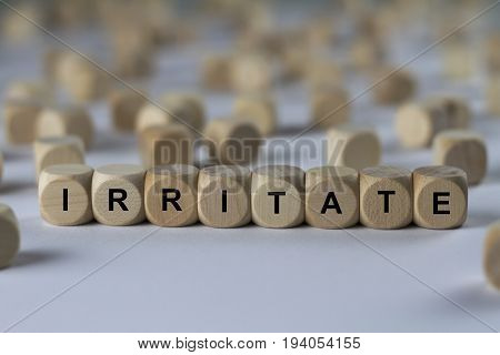 Irritate - Cube With Letters, Sign With Wooden Cubes