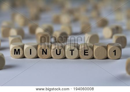 Minute 1 - Cube With Letters, Sign With Wooden Cubes