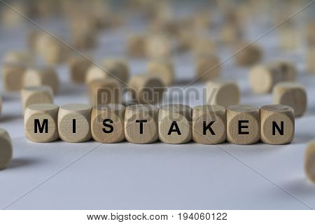 Mistaken - Cube With Letters, Sign With Wooden Cubes