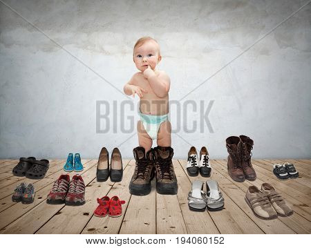 Picture child standing in the middle of many shoes