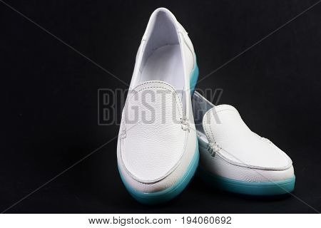 Pair Of Female Leather Shoes Dark Blue Or Black Background