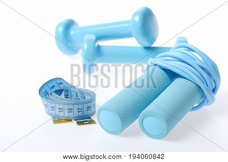 Composition Of Sportive Lifestyle With Folded Cyan Skipping Rope