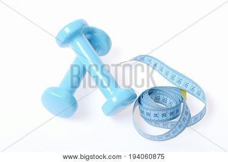 Composition Of Cyan Blue Dumbbells And Roll Of Measuring Tape