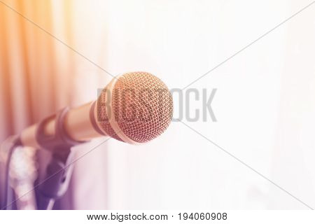 Close focus on classic gold microphone with colorful light.