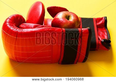 Sport Equipment And Fruit On Bright Yellow Background