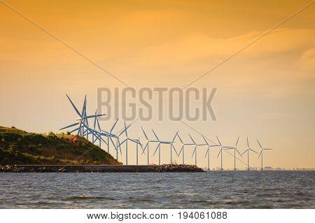 Wind turbines generator farm for renewable sustainable and alternative energy production along coast baltic sea near Denmark. Eco power ecology.