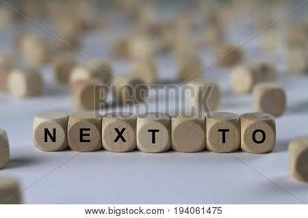 Next To - Cube With Letters, Sign With Wooden Cubes