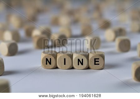 Nine - Cube With Letters, Sign With Wooden Cubes