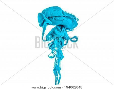 Ink swirl in a water, isolated on white background. The paint in the water. Soft dissemination a droplets of colored ink in water close-up. Explosion of color splashes acrylic ink.