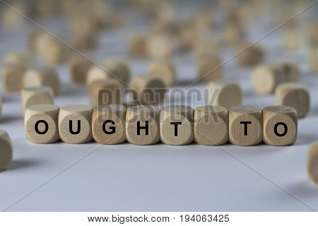 Ought To - Cube With Letters, Sign With Wooden Cubes