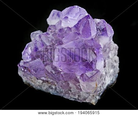 an amethyst crystals on a black background