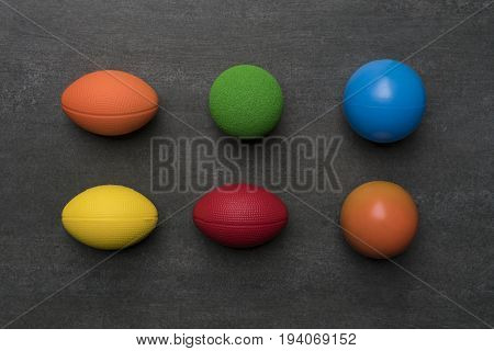 colorful of stress balls on black background