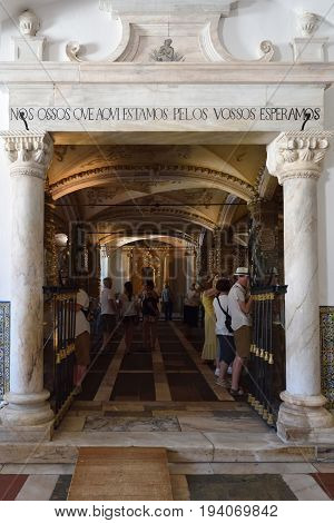 Evora Portugal - June 12 2017: Entrance in Chapel of Bones is one of the best known monuments in Evora. The message above entrance means: We bones that here are for yours await