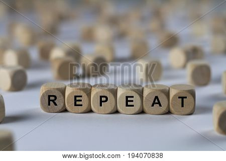 Repeat - Cube With Letters, Sign With Wooden Cubes