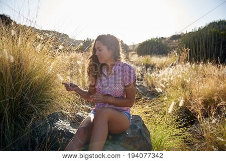 Girl Sitting On A Large Rock