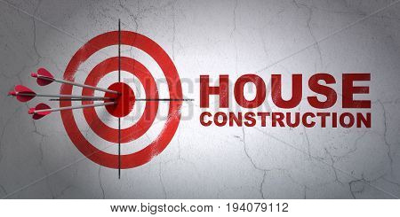 Success building construction concept: arrows hitting the center of target, Red House Construction on wall background, 3D rendering