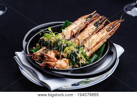 Royal prawns served with herbs and quinoa.