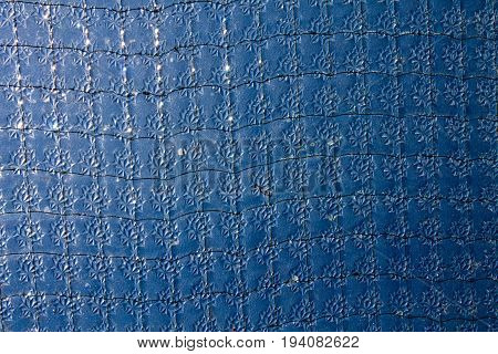 Blue stained glass texture surface for background.