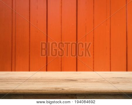 wooden counter top with orange wall background