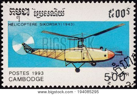 Moscow Russia - July 06 2017: A stamp printed in Cambodia shows Sikorsky Helicopter (1943) series