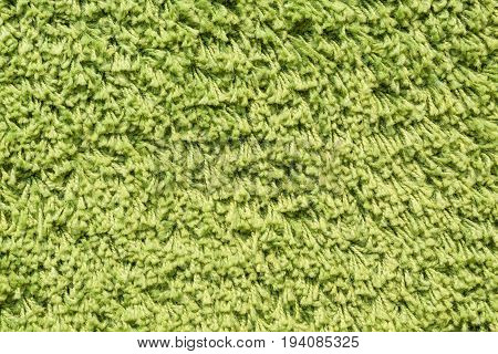 green carpet background or green doormat background