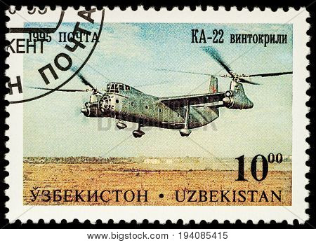 Moscow Russia - July 05 2017: A stamp printed in Uzbekistan shows helicopter Kamov KA-22 series