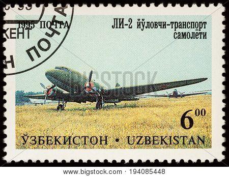 Moscow Russia - July 05 2017: A stamp printed in Uzbekistan shows airplane Lisunov LI-2 series