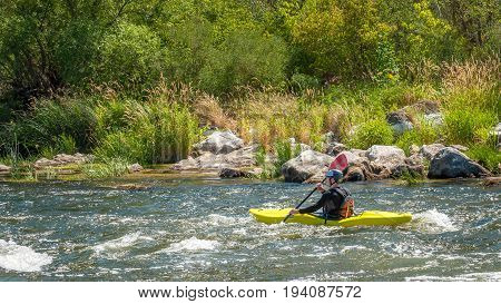 Village Myhiya Nikolaev region Ukraine - July 2 2017: Kayaking on the Southern Bug River in sunny weather. A popular place for extreme recreation and training of rafting and kayaking athletes.