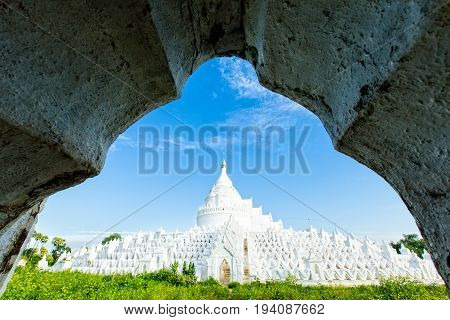 The Hsinbyume Pagoda is a large pagoda on the northern side of Mingun in Sagaing Region in Myanmar on the western bank of the Irrawaddy River. The pagoda's design is a great departure from Burmese pagoda design norms. It is based on descriptions of t poster