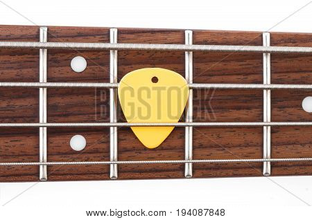 Metallic volume treble guitar bass knobs. Electric guitar. Red electric bass guitar close-up. Musical instrument. Music. Four strings. Grif.