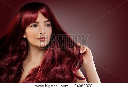 Fashion Model Woman with Red Hairstyle. Redhead Girl on Background with Copyspace
