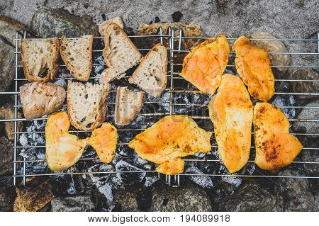 Chicken And Bread On Homemade Improvised Bbq Barbecue Grill.