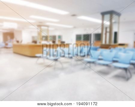 abstract blurred image of empty chairs in waiting room at hospital sunlight effect