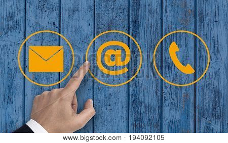 Hand Pointing At Contact Options Icons E-mail Letter Telephone