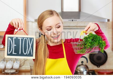 Woman Holding Detox Sign And Shopping Basket With
