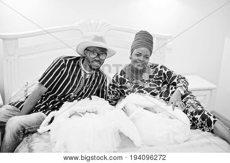 Gorgeous African American Family Consisting Of Traditionally Dressed Parents And Little Kids Posing