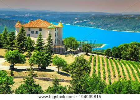 Amazing Aiguines castle with spectacular vineyard and beautiful turquoise St Croix lake in background near Verdon gorge Provence France Europe