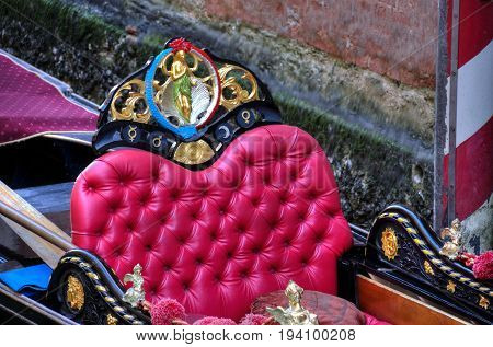 Close up of a red seat in a gondola.