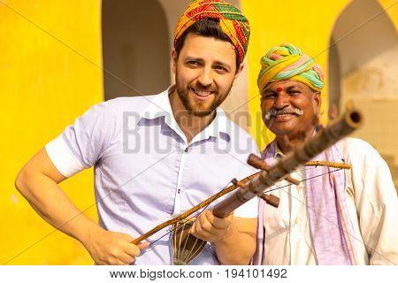 Tourist playing traditional rajasthani music on the street of Jaipur, Rajasthan, India