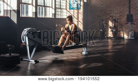 Young Woman Relaxing During Work Out At The Gymnasium.
