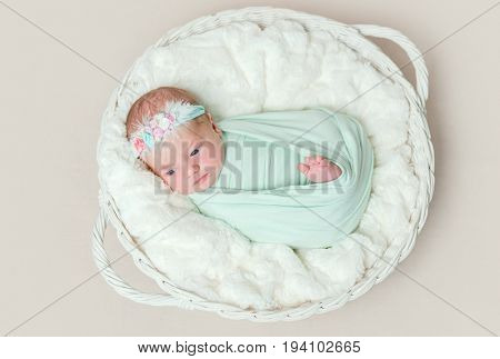 Adorable swaddled baby with legs moving