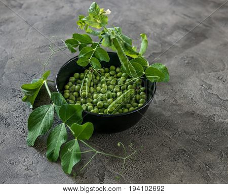 Rustic bowl with green peas, naturally grown