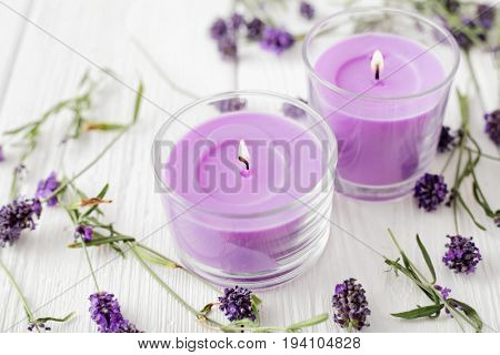 aromatherapy candles and lavender flowers