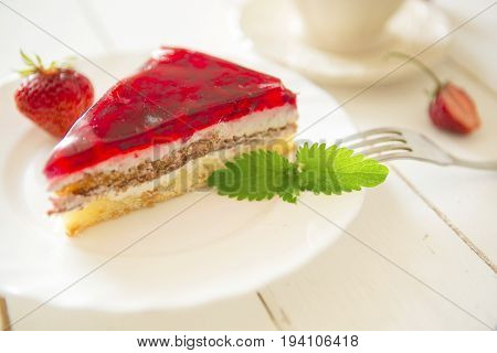 Strawberry Tart On Plate On White Wooden Table