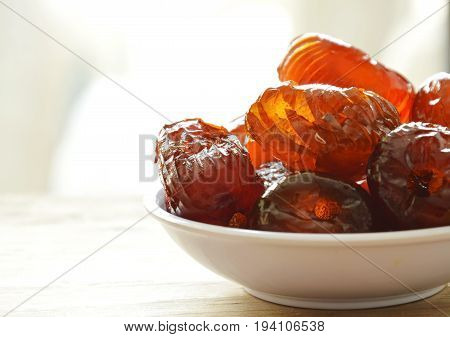 Chinese jujube candy coating syrup on little cup