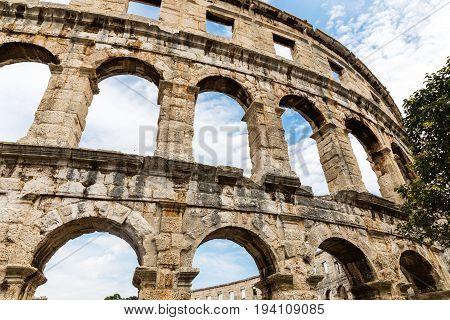 wall of roman amphitheatre arena in pula croatia